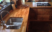 Oak worktops look fantastic alongside solid wood cabinetry.