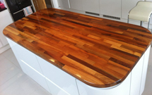 Walnut worktops make an ideal surface for a kitchen island.