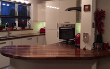 American walnut, cut with a large, irregular ellipse end and a variety of custom cuts.