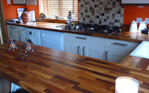 Walnut worktops run the full length of this modern kitchen.