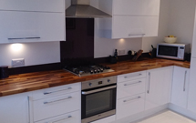 Walnut worktops look excellent alongside modern glossy white kitchen units.