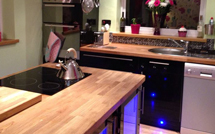 Beech worktops supplied with cut-outs for an over-mounted sink and electric hob.