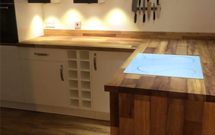 Our Deluxe Iroko worktops are warm, inviting and a real talking point for new kitchens.