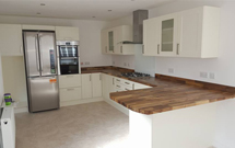 European walnut contrasts beautifully with modern Shaker style kitchen units.