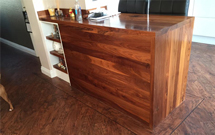 Full Stave Black American Walnut worktops used to create an elegant breakfast bar.