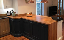 Full Stave Oak worktops in a high-end kitchen with some beautiful customisations.