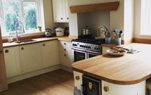 Our full stave oak is the perfect wooden worktop for complementing this kitchen's oak beams.