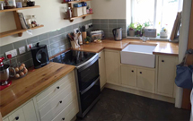 Full stave oak worktops in a traditional kitchen with bespoke kitchen units.