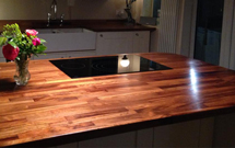 Iroko worktops used to create a spacious kitchen island.