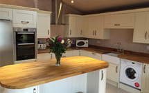 Freshly installed iroko worktops look yellow but quickly mature into a golden brown over time.