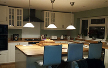 A beautiful solid wood kitchen featuring oak worktops throughout.