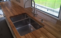 A bespoke oak worktop with sink cut-out and drainage grooves.