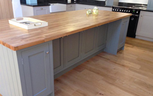 Oak worktops are the ideal choice for a statement island in a traditional kitchen.