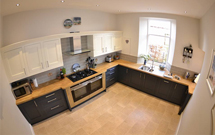 The consistent colour of our Prime Oak worktops is the perfect match for this large, open kitchen.
