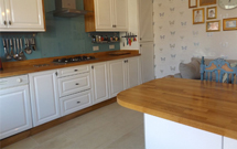 Oak worktops are the perfect choice alongside solid wood traditional cabinet frontals.