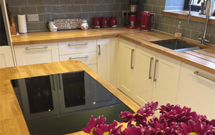 A kitchen island topped with one of our oak worktops.