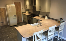 This kitchen fuses traditional elements with more modern features, and is finished by our beautiful oak worktops.
