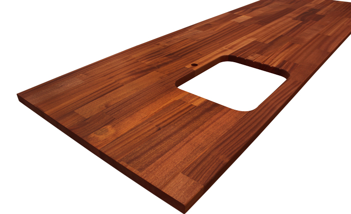 This Deluxe Sapele worktop had a number of customisations to create a beautiful kitchen island surface.