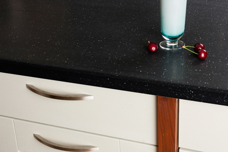 Earthstone worktops replicate the look of real stone worktops but - unlike stone - can be repaired if damaged.