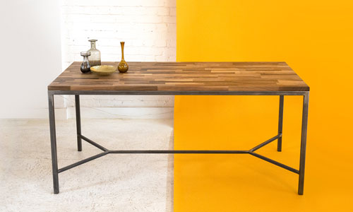 This elegant walnut table was made by the team at the Goldfinger Factory using repurposed wood and steel box section.