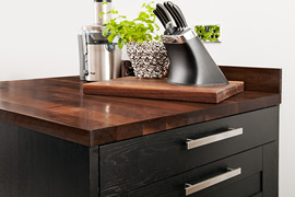 Sumptuous full stave American walnut worktops are complemented with a matching chopping board for sheer luxury.