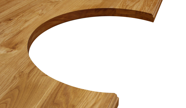 A full stave oak worktop that has a semi-circular cut out and an ogee edge profile wooden worktops.
