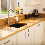 Full stave Prime Oak worktops with matching kitchen upstands.