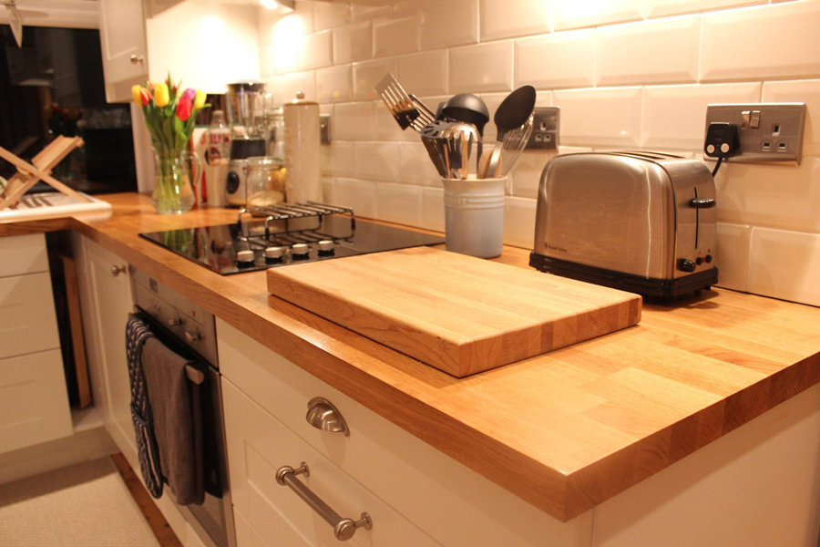 Oak Worktops In Kitchen With Solid Oak Chopping Board.