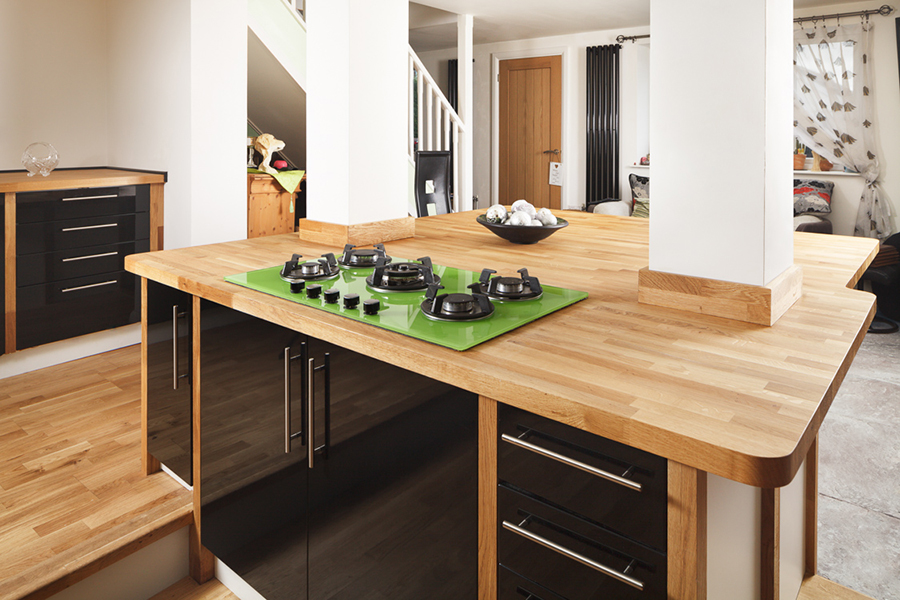 Matching Solid Oak Upstands Protect The Columns Which Divide This Wooden  Kitchen Island.