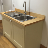 Our bamboo worktops work equally well with contemporary stainless-steel sinks and traditional kitchen cabinets.