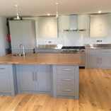 Bamboo worktops can be used to great effect for kitchen islands with plenty of storage space.