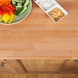 Beech worktops can mix beautifully with wooden cabinets and are very hard-wearing.