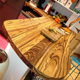 An unusual bespoke full stave zebrano worktop that doubles as a curvy breakfast bar.