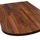 A black American walnut worktop with smooth ellipse end and pencil edge profile.