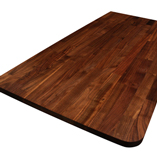 Black American walnut worktop with 50mm radius corner.
