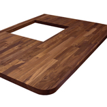 Black American walnut worktop with three soft radius corners and a hob cut-out.