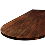A black American walnut worktop for a kitchen island, featuring a large ellipse end.