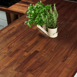 The rich tones of Black American walnut suits both contemporary and traditional kitchens.