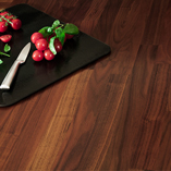 Our solid black American walnut worktops are incredibly smooth and hard-wearing surfaces.