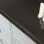 Black gloss laminate worktops are a beautiful choice for combining with solid wood furnishings.