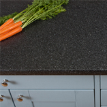 Black quartz laminate worktops from Worktop Express feature subtle reflective specks that catch the light to recreate the look of real quartz.