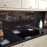 This customer has a kitchen featuring our Black Sparkle worktop, showing how beautiful the surface is.