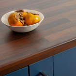 These black walnut block effect laminate surfaces have a soft sheen that imitates the look of oiled timber.
