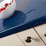 These blue sparkle Andromeda surfaces have a high-gloss finish, making them an eye-catching centrepiece in any kitchen