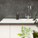This Grey Quartz laminate Brasilia worktop has a gloss finish and a marled grey colouring.