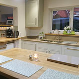 A bright and contemporary neutral kitchen that uses our 90mm Full Stave Oak worktops.