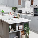 Calcutta marble laminate worktops work well with grey cabinets for a sleek, sophisticated look.
