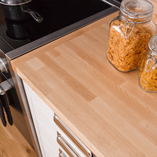 Combining Calgary polished nickel kitchen cabinet handles with ash worktops is highly effective.