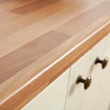 Cherry block laminate worktops feature a 3mm pencil edge profile.