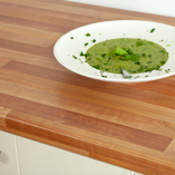 Cherry-effect laminate worktops are a warm, welcoming choice for any kitchen.